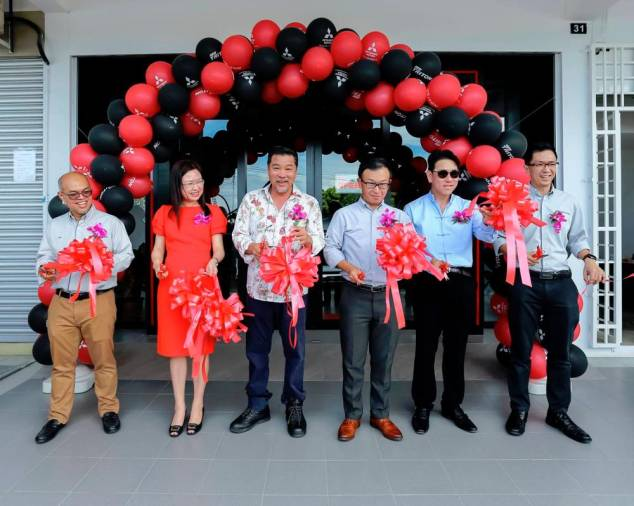 $!Management team of MMM and Auto Pacifica during the ribbon cutting ceremony.