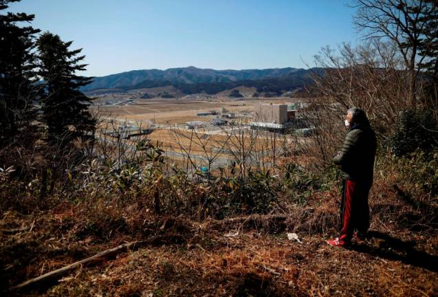 Japan's tsunami survivors call lost loves on the phone of the wind