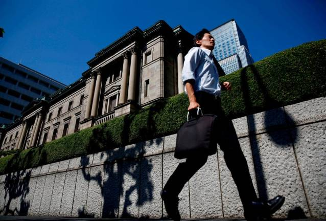 If markets stay calm, BOJ may hold fire despite ECB's loosening