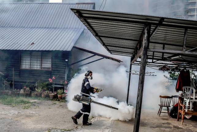 A residential area in Kampung Baru, Kuala Lumpur is fumigated as part of an anti-dengue operation as the nation is gripped by the Covid-19 pandemic. SUNPIX BY ADIB RAWI YAHYA
