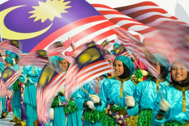 Malaysian students waving Jalur Gemilang's during the 59th National Day celebrations at Dataran Merdeka in Kuala Lumpur in 2017, Asyraf Rasid / the sun