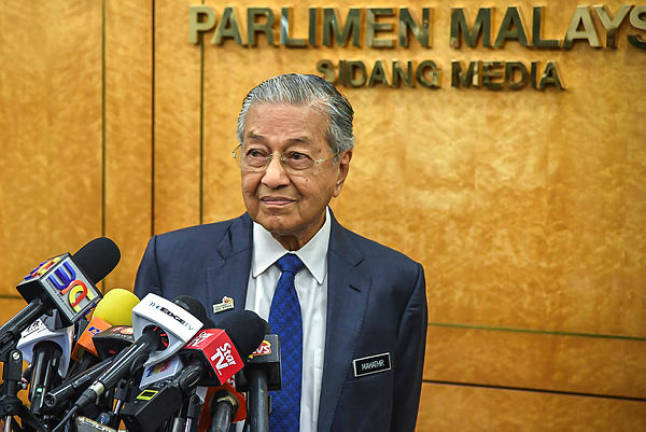 Dropping of murder charge against Siti according to law, says Mahathir
