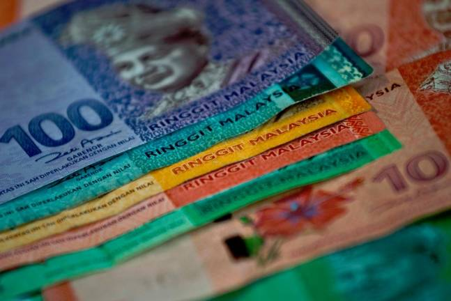 Malaysia's possible exclusion from global bond index spooks ringgit, stocks