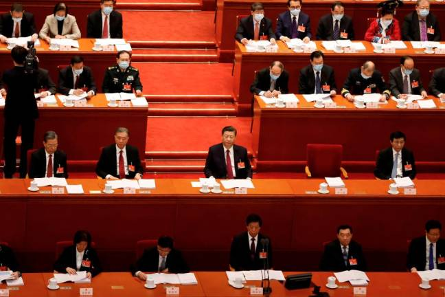 (Updated) China's parliament to delay Hong Kong legislative vote, overhaul electoral system