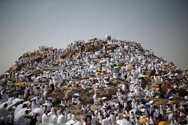 Muslim pilgrims perform prayers in Arafat during the annual haj pilgrimage, outside the holy city of Mecca. REUTERS PIX
