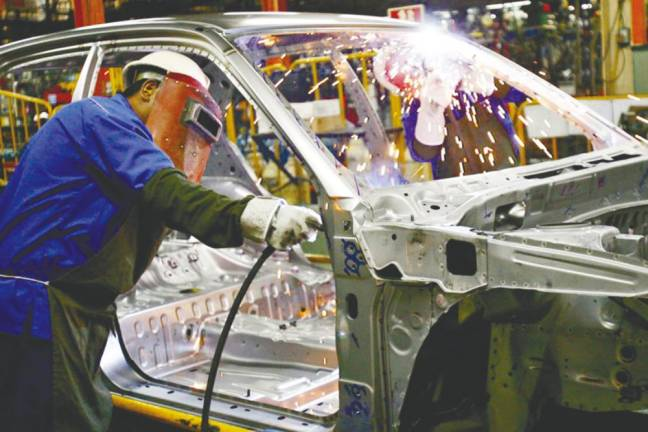 Malaysia's manufacturing moderates fractionally in November