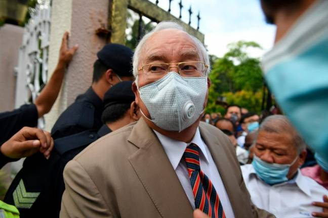 Court sentences Najib to total of 72 years in jail, fines him RM210m