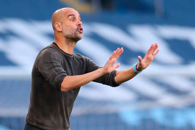 Guardiola calls for Man City cool heads to see off PSG