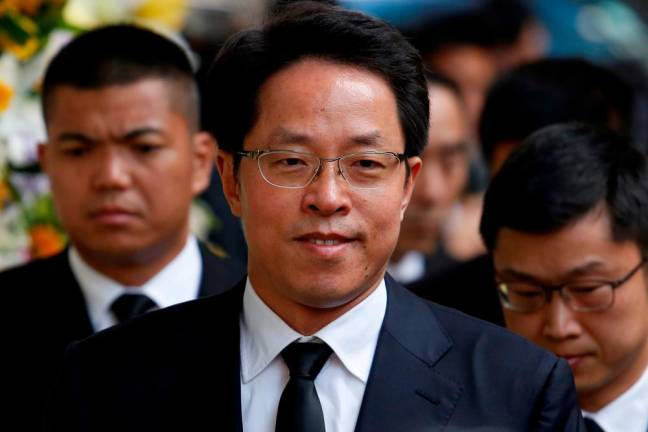 China demotes top official in charge of Hong Kong