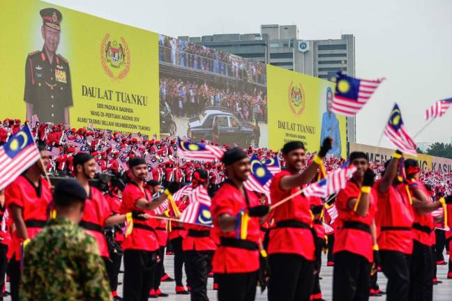 "In 2015, Malaysians had the opportunity to witness almost 13,000 participants from the public and private sector, security forces, school students and as well as a group of mountain trekkers in a mesmerising parade at Dataran Merdeka in conjunction with the National Day celebrations themed ""#sehatisejiwa"" (One Heart, One Soul). Adib Rawi Yahya/theSun"