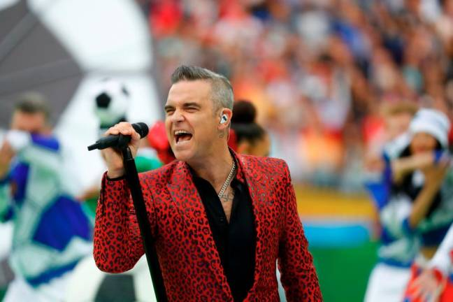 Robbie Williams takes stake in college