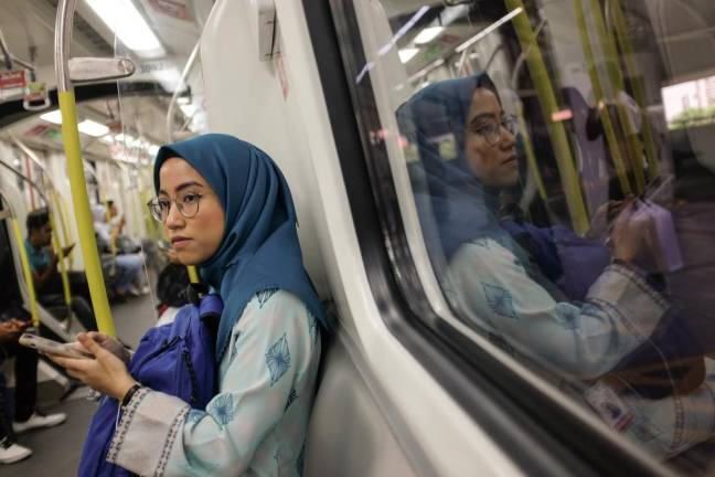 Phoenix taking the evening train to the MyPW development centre . Asyraf Rasid / the sun