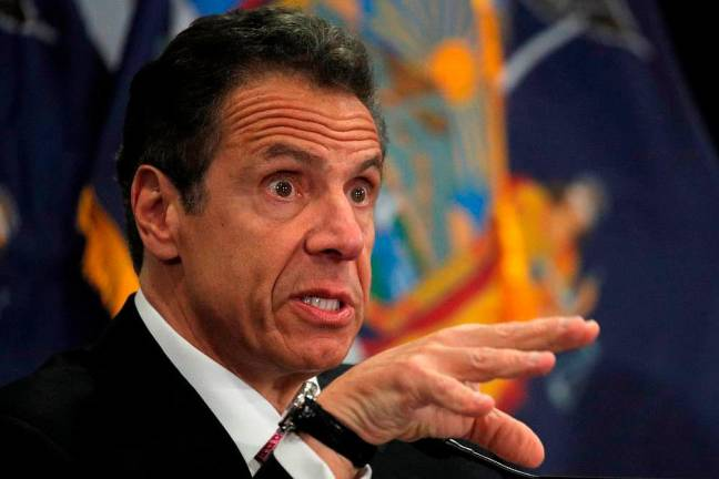 Third woman accuses New York governor of sexual harassment