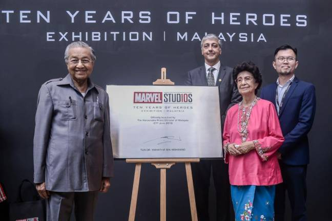 Tun Mahathir with Tun Siti Hasmah officially opening the Marvel Studios: Ten Years of Heroes exhibition. SUNPIX BY ADIB RAWI
