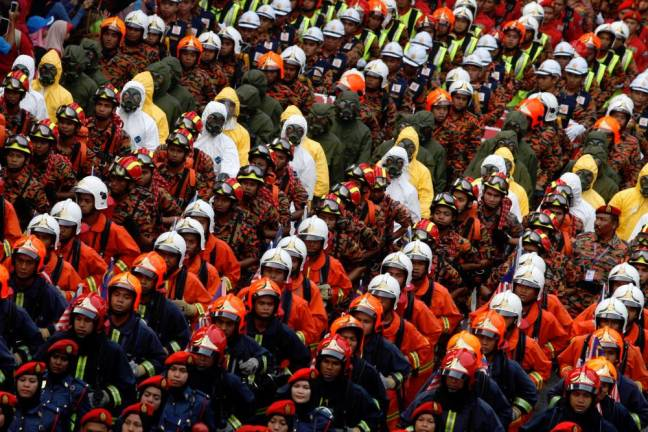 Members of The Fire and Rescue Department of Malaysia march during the 58th National Day celebrations in 2015. Asyraf Rasid/the sun
