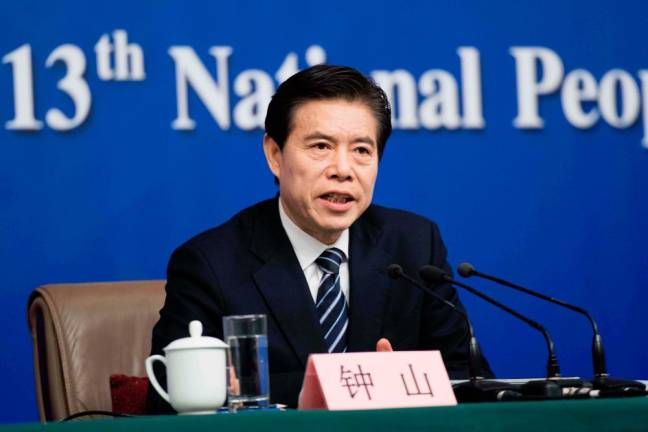China to reduce curbs on foreign investment