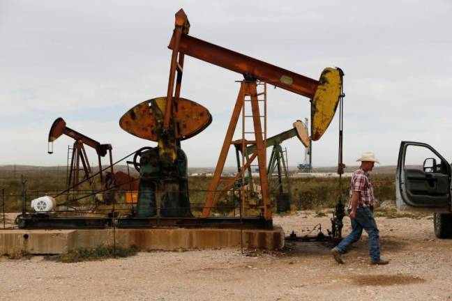 Oil prices mixed as demand shrinks, but stimulus hopes support