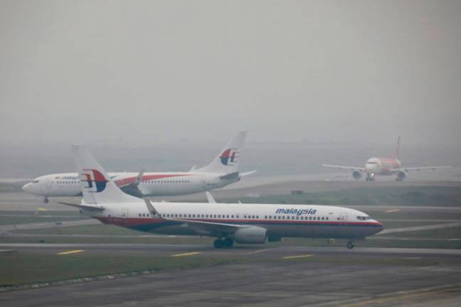 Malaysia Airlines airplanes are pictured on the haze-shrouded tarmac at Kuala Lumpur International Airport in Sepang, Malaysia, September 18, 2019. REUTERS PIX