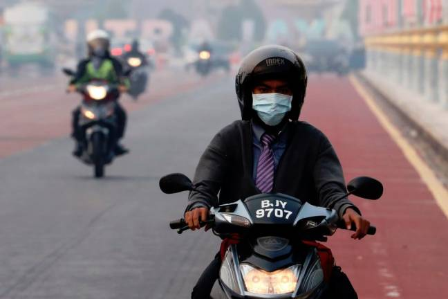 A man rides on a motorcycle in the haze in Putrajaya, Malaysia, September 17, 2019. REUTERS PIX