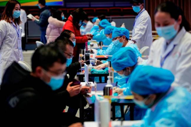 China reports 103 new COVID-19 cases vs 118 a day earlier