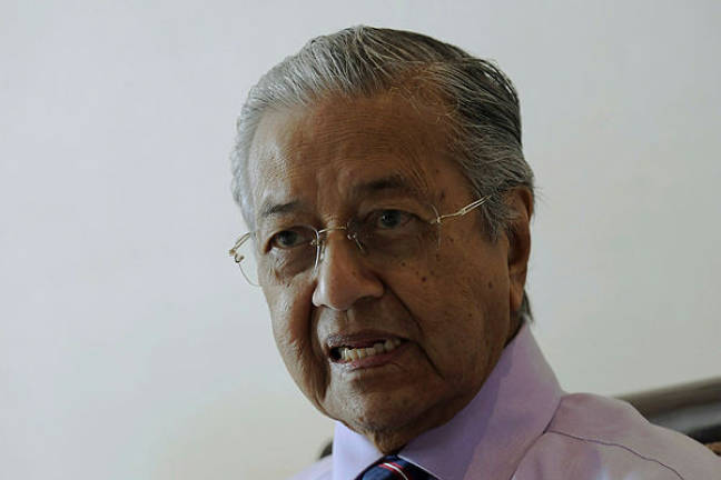 Mahathir throws spanner in the works on proposed Umno-PAS charter
