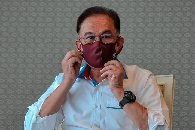 Anwar asks all MPs to plead with the King to revoke emergency