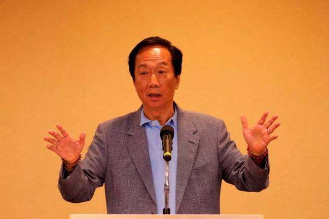Foxconn's Gou quits Taiwan's KMT, paving way for presidential bid