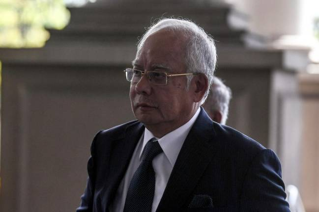 Najib campaigning in Camerons 'at people's request'