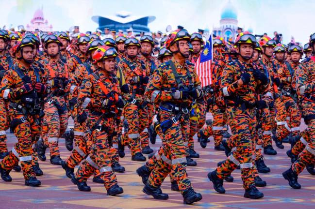 Fire and Rescue Department personnel marching during the 61st Merdeka Day celebration parade in Putrajaya in 2018. KAMARIDUAN MOHD NOR/THE SUN