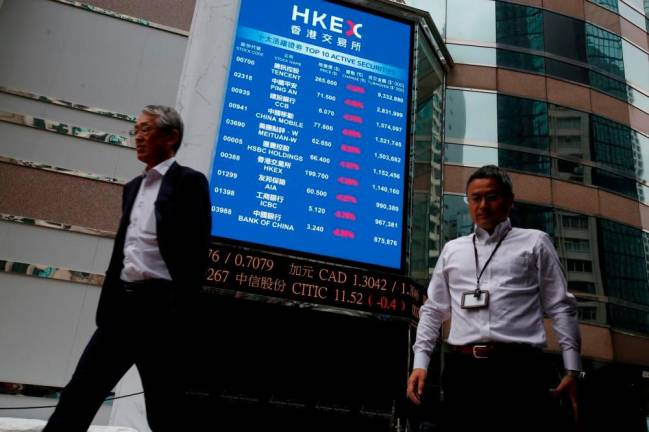 Hong Kong exchange shares fall as political risks of $39 bln LSE approach weigh