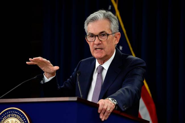 Federal Reserve makes small changes to control benchmark rate, hints at more to come