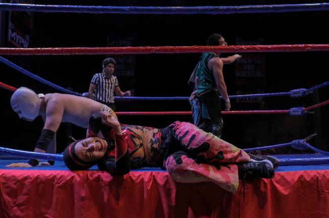Nor Phoenix Diana struggles after she was slammed onto the side of the ring. Asyraf Rasid / the sun