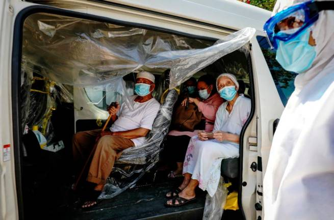 A group of senior citizens from Kampung Baru in Kuala Lumpur being taken for COVID-19 test in a sanitised vehicle. SUNPIX BY HAFIZ SOHAIMI