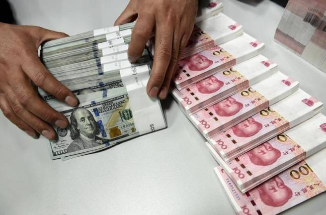 Yuan eases off 1-mth high, focus back on trade after upbeat GDP