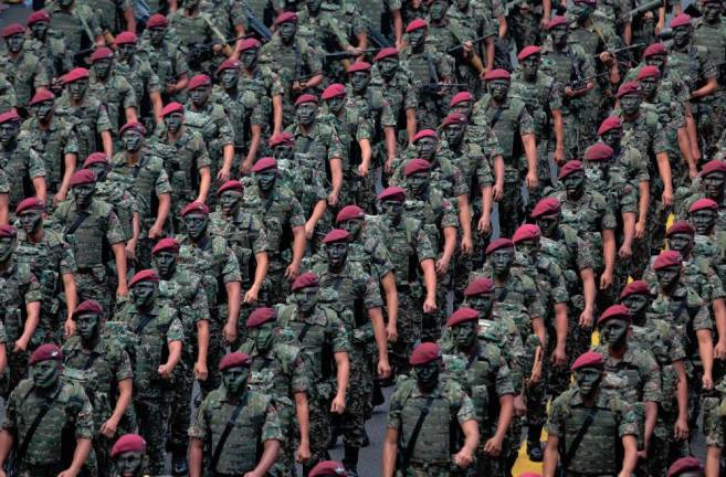 Malaysian Armed Forces personnel marching during the 60th Merdeka Celebration parade at Dataran Merdeka Kuala Lumpur, in 2017. Amirul Syafiq Mohd Din / The Sun