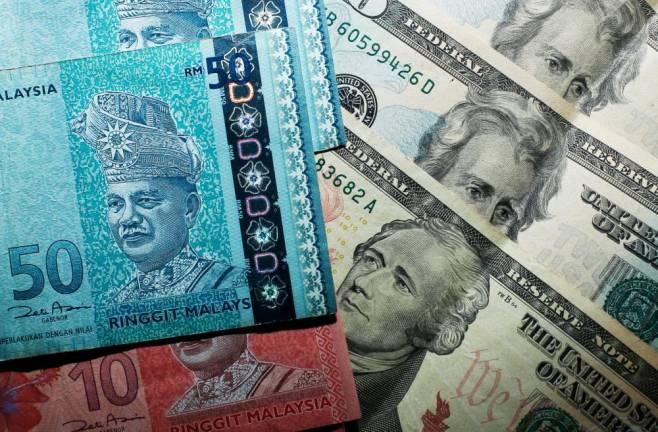 Fitch forecasts ringgit to weaken in 2020 on domestic political risks, rebound in 2021