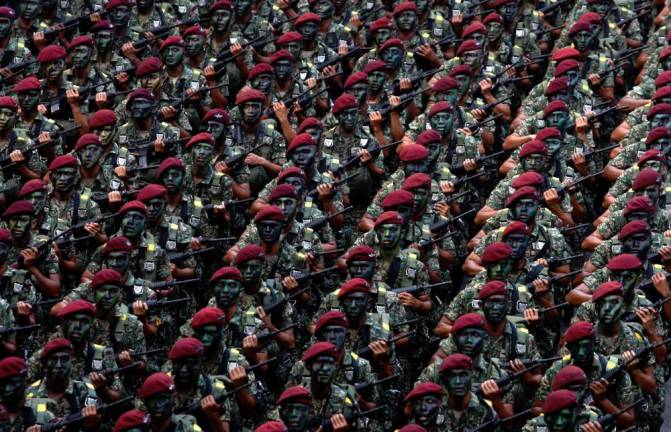 Members of Malaysia's armed forces march during 58th National Day celebrations in 2015. Asyraf Rasid/the sun