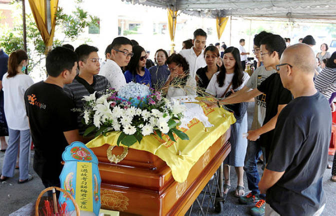 Tearful farewell for Penang Bridge crash victim Moey