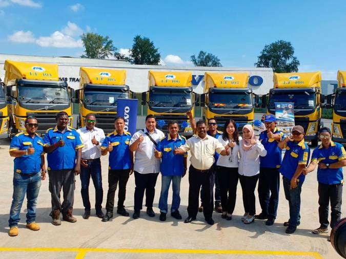 Group photo of staff from Volvo Trucks Prai dealership and LTS Group.
