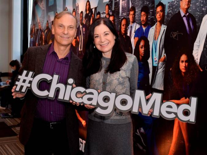 (FILES) In this file photo taken on November 9, 2015 Executive Producers Andrew Schneider and Diane Frolov attend a press junket for NBC's 'Chicago Fire', 'Chicago P.D.' and 'Chicago Med' at Cinespace Chicago Film Studios in Chicago, Illinois. -AFP / GETTY IMAGES NORTH AMERICA / Daniel Boczarski