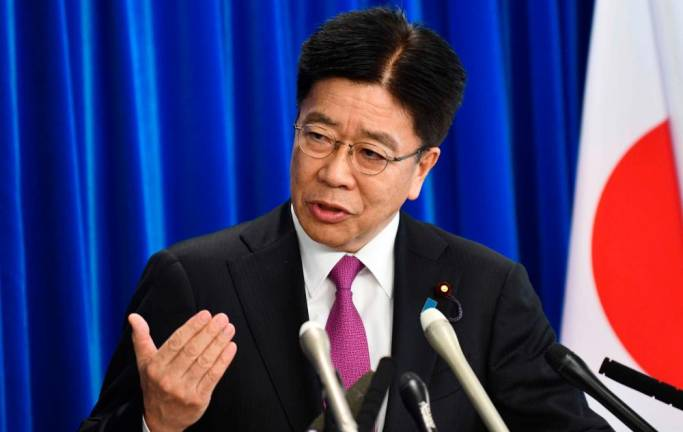 Third death from Japan cruise ship as health minister vows to set virus strategy