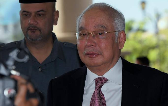 Ahmad Husni's 'office boy' claim 'is a comedy', says Najib