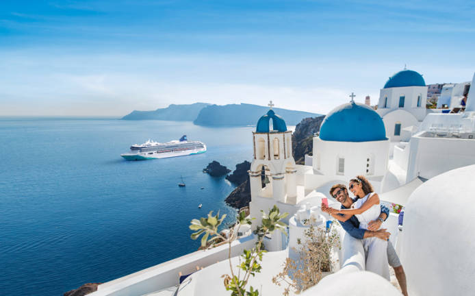 Cruising to Santorini: The Norwegian Cruise Line has announced plans to expand to new ports in 2021 to 2023, even as an estimated 100,000 cruise ship passengers are still trapped at sea.