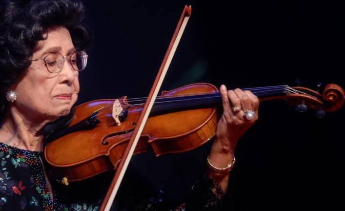Prime Minister wife Tun Dr Siti Hasmah Mohd Ali playing the violin after the launch of Tun Dr Siti Hasmah Mohd Ali Scholarship for Creative Arts and Music during the National Women's Day Gala Dinner at Sunway Hotel and Resort tonight. AMIRUL SYAFIQ MOHD DIN / THESUNN