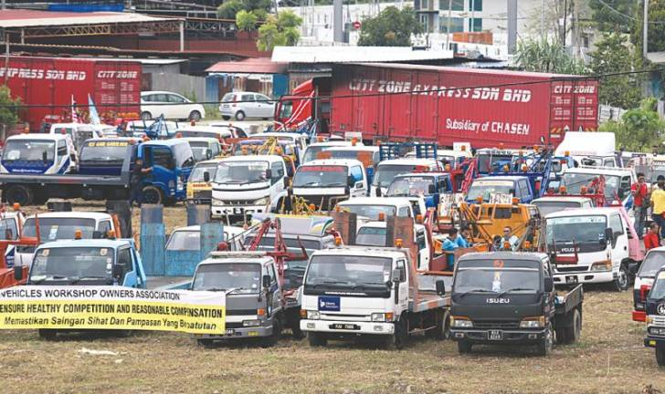 Tow truckers go on strike in Penang
