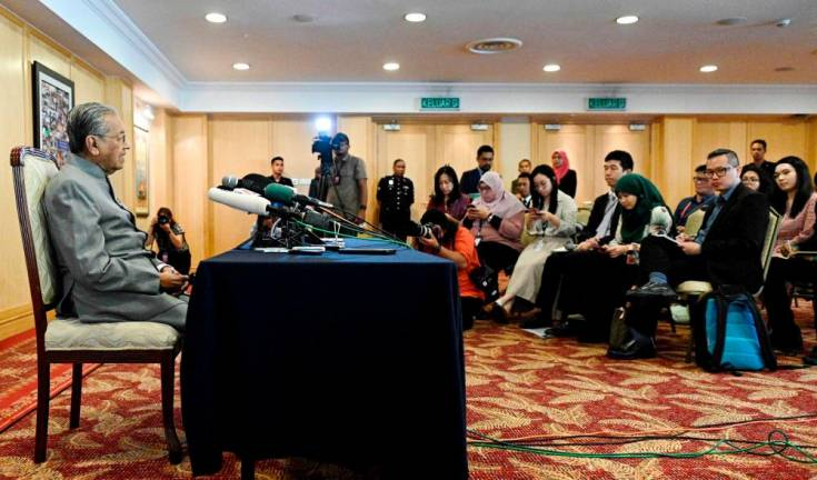 Prime Minister Tun Dr Mahathir Mohamad fields questions at a press conference to mark the first anniversary of New Malaysia at the Putrajaya International Convention Centre in Kuala Lumpur on May 9. AFPpix