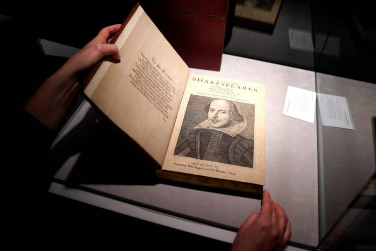 $!An employee of Christie's auctions holds a 1663 rare first folio of 36 Shakespeare works that was sold for a record 8.4 million dollars (9.978 million with buyers fee) in the Manhattan borough of New York City, New York, U.S., October 14, 2020. REUTERS/Carlo Allegri