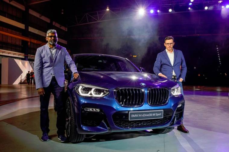 Hoelzl (right) and BMW Group Malaysia head of corporate communications Sashi Ambi with the second-generation BMW X4.