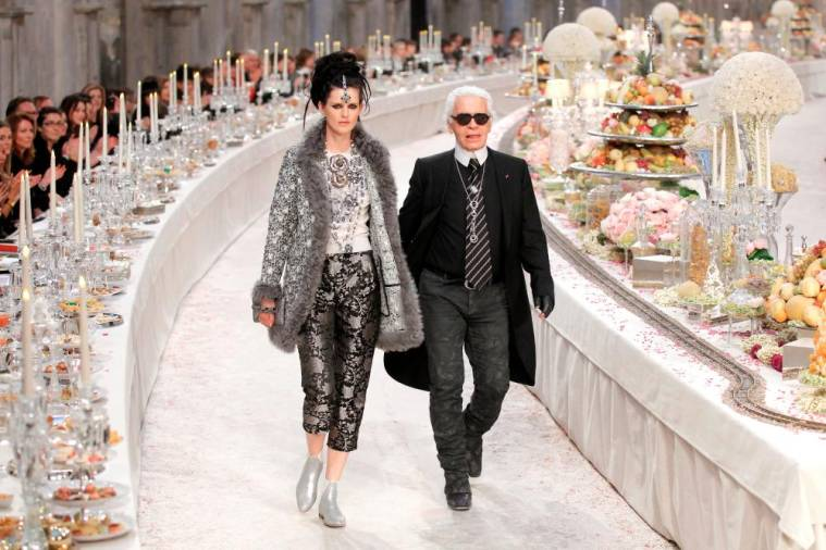FILE PHOTO: British model Stella Tennant walks with designer Karl Lagerfeld during the Metiers D'Art Show for Chanel fashion house in Paris December 6, 2011. The show, which exists since 2003, is an homage to Chanel workshops. REUTERS/Benoit Tessier