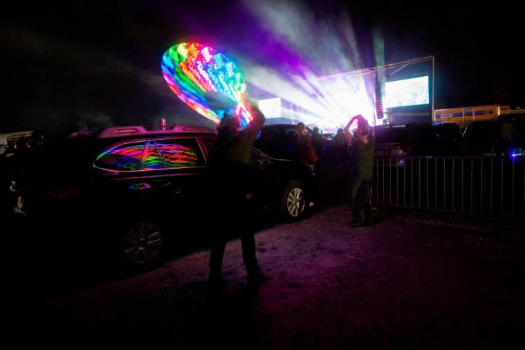 Attendees watch the The Disco Biscuits perform during the Montage Mountain rave on October 23, 2020 in Scranton, Pennsylvania. / AFP / Kena Betancur